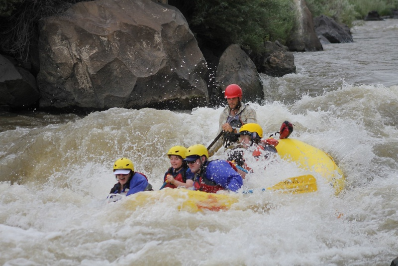 group of people rafting down a river