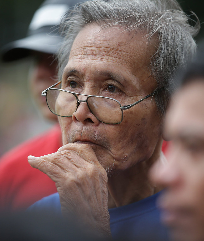 . An elderly Filipino man walks at Rizal Park, in Manila, Philippines on Sunday, Sept. 29, 2013. Much of the world is not prepared to support the ballooning population of elderly people, including many of the fastest-aging countries, according to a global study scheduled to be released Tuesday, Oct. 1, by the United Nations and an elder rights group. (AP Photo/Aaron Favila)