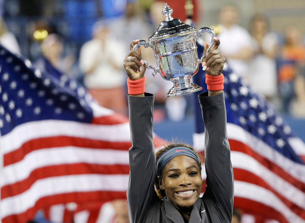 . Serena Williams holds up the championship trophy after defeating Victoria Azarenka, of Belarus, during the women\'s singles final of the 2013 U.S. Open tennis tournament, Sunday, Sept. 8, 2013, in New York. (AP Photo/David Goldman)
