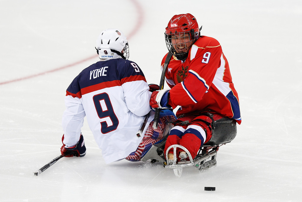 . Konstantin Shikhov of Russia (R) collides with Andy Yohe of USA during the Ice Sledge Hockey Gold Medal match between Russia and USA at the Shayba Arena during day eight of the 2014 Paralympic Winter Games on March 15, 2014 in Sochi, Russia.  (Photo by Harry Engels/Getty Images)