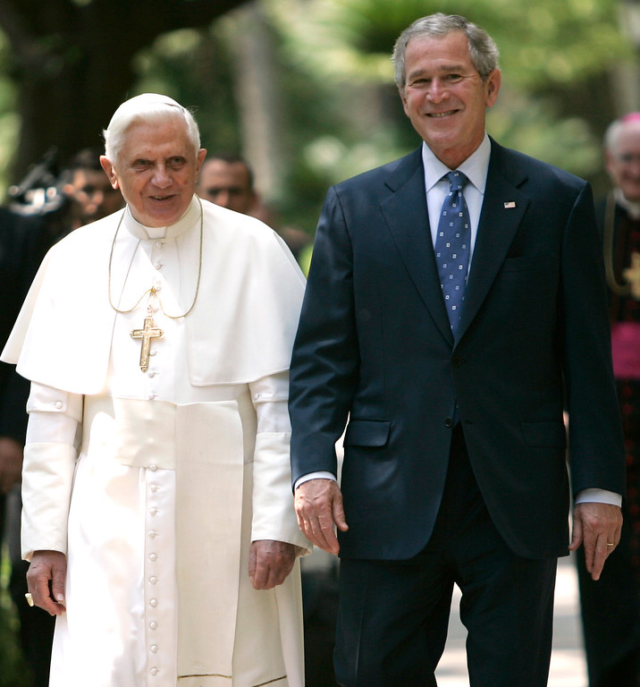 . President Bush walks with Pope Benedict XVI to the Lourdes Grotto at the Vatican, Friday, June 13, 2008.   (AP Photo/Evan Vucci)
