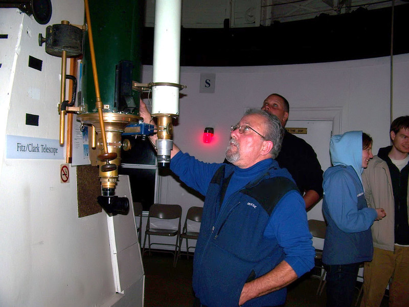 Paul Campbell  at the eyepiece of the 13 inch Fitz Clark refractor pointing to the zenith.