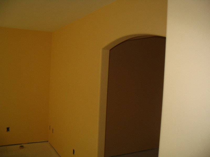 The painters have been hard at work in the master bedroom (showing the entry into the closet on the right).