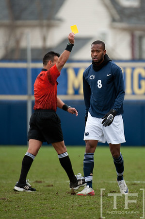 Nov 13, 2011; Ann Arbor, MI, USA; Penn State Nittany Lions forward Hasani Sinclair (8) receives a yellow card in the second half at the final game of the 2011 Big Ten Championship against the Northwestern Wildcats at Michigan Soccer Stadium. Wildcats won 2-1. Mandatory Credit: Tim Fuller-US PRESSWIRE