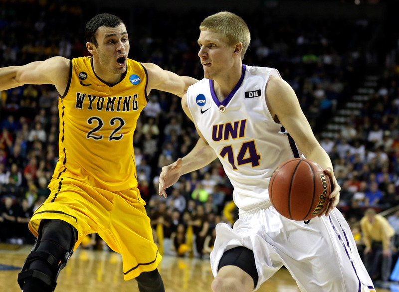 . Northern Iowa forward Nate Buss (14) drives around Wyoming forward Larry Nance Jr. (22) during the second half of an NCAA tournament college basketball game in the Round of 64 in Seattle, Friday, March 20, 2015. Northern Iowa beat Wyoming 71-54. (AP Photo/Ted S. Warren)