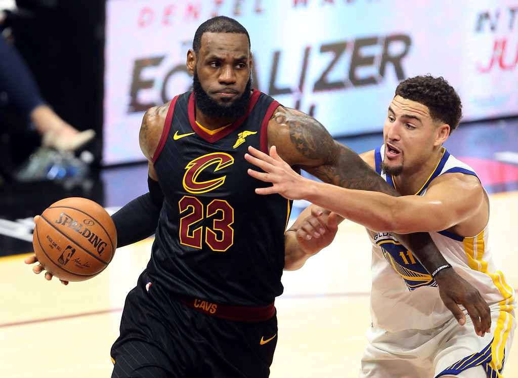 . Cleveland Cavaliers forward LeBron James drives against Golden State Warriors guard Klay Thompson during the first half of Game 3 of basketball\'s NBA Finals on Wednesday, June 6, 2018, in Cleveland. (Joshua Gunter/Cleveland.com via AP)