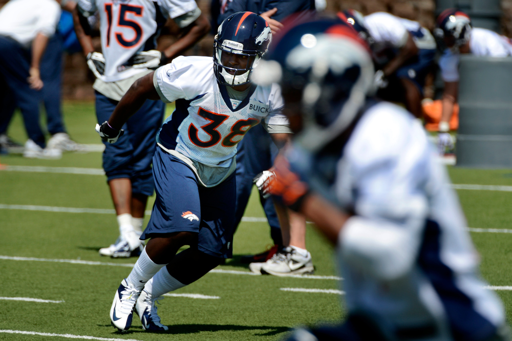 . Rookie running back # 38 Montee Ball running plays at Broncos rookie minicamp at the Broncos Dove Valley facility May 10, 2013 Centennial, Colorado. (Photo By Joe Amon/The Denver Post)