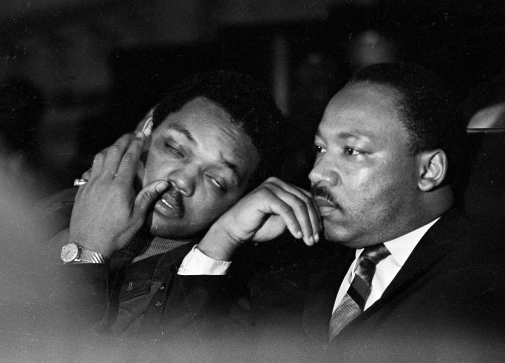 . Dr. Martin Luther King, Jr. is seen here with Rev. Jesse Jackson, left, just prior to his final public appearance to address striking Memphis sanitation workers on April 4, 1968.  King was assassinated later that day outside his motel room.  (AP Photo/Charles Kelly)