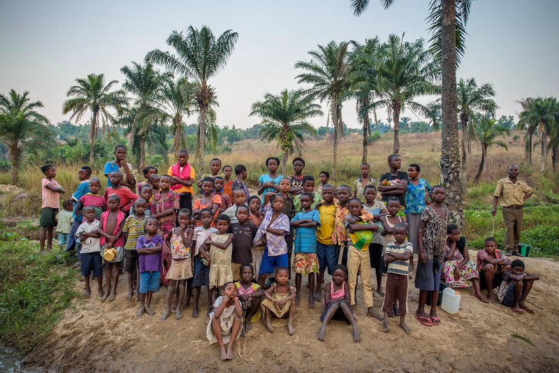 People at the water collection point in Nganza , Kananga, DRC, where Kapinga collects water.