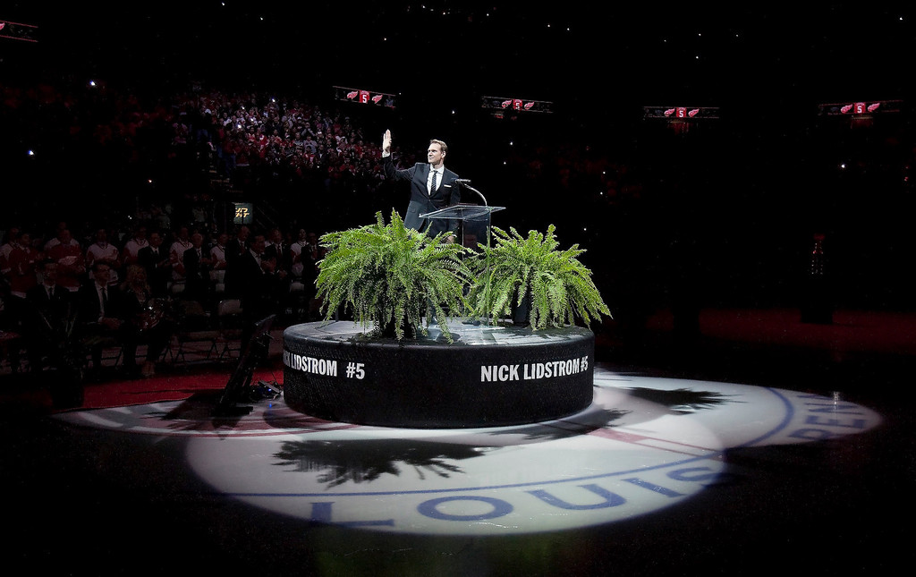 . Former Detroit Red Wing Nicklas Lidstrom waves to the crowd during the retirement ceremony for his No. 5 before an NHL hockey game between the Detroit Red Wings and Colorado Avalanche at Joe Louis Arena, Thursday, March 6, 2014, in Detroit. (AP Photo/Duane Burleson)