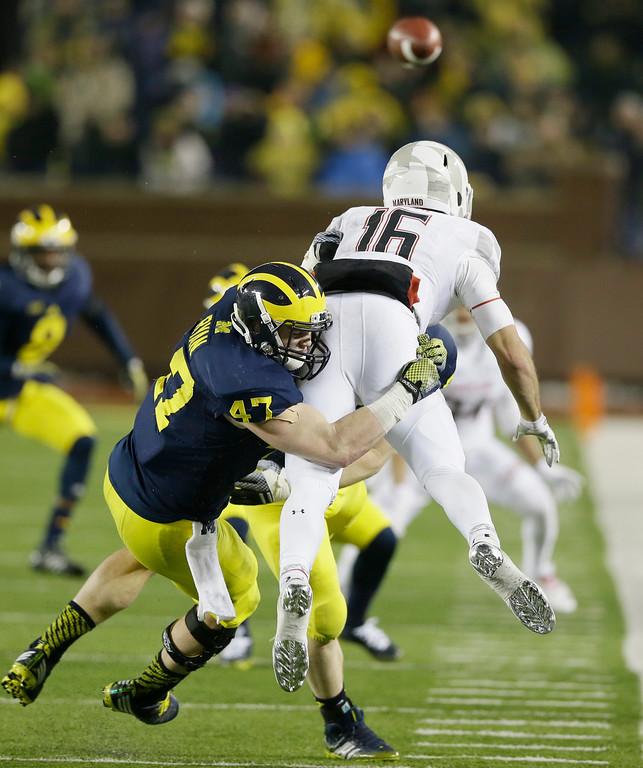 . Michigan linebacker Jake Ryan (47) tackles Maryland quarterback C.J. Brown during the second half of an NCAA college football game in Ann Arbor, Mich., Saturday, Nov. 22, 2014. (AP Photo/Carlos Osorio)