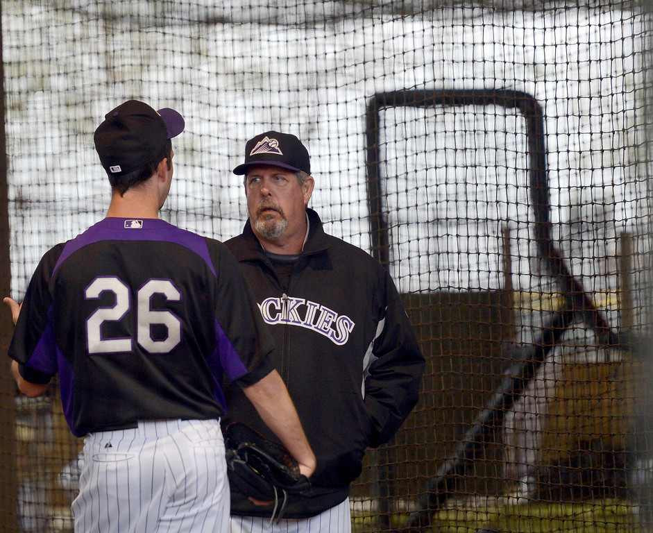 . SCOTTSDALE, AZ. - FEBRUARY 20: Bo McLaughlin, assistant pitching coach talks with Jeff Francis in the batting cages where the  Colorado Rockies had to workout in due to rain during Spring Training  February 20, 2013 in Scottsdale. (Photo By John Leyba/The Denver Post)