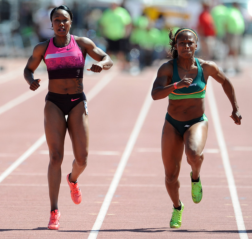 . Olympian Carmelita Jeter, left, slows-up with an injury the 100 meter dash invitational elite as Laura Williams competes during the Mt. SAC Relays in Hilmer Lodge Stadium on the campus of Mt. San Antonio College on Saturday, April 20, 2012 in Walnut, Calif.    (Keith Birmingham/Pasadena Star-News)