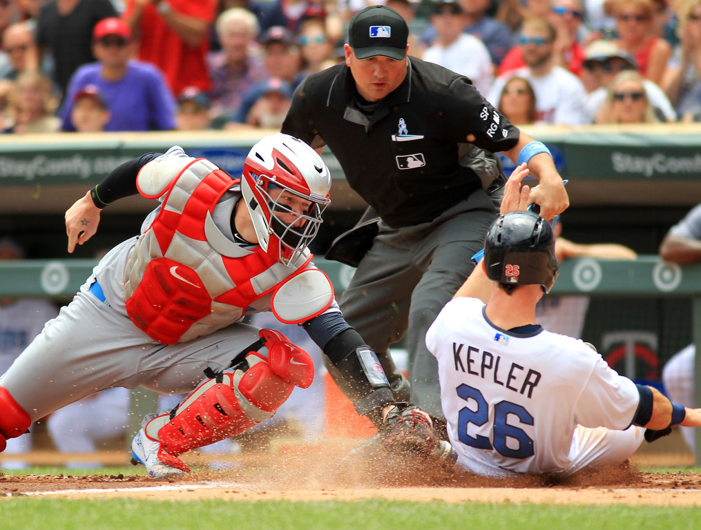 . Cleveland Indians catcher Roberto Perez (55) tags out Minnesota Twins Max Kepler (26) in the second inning during their baseball game on Sunday, June 18, 2017 in Minneapolis. (AP Photo/Andy Clayton-King)