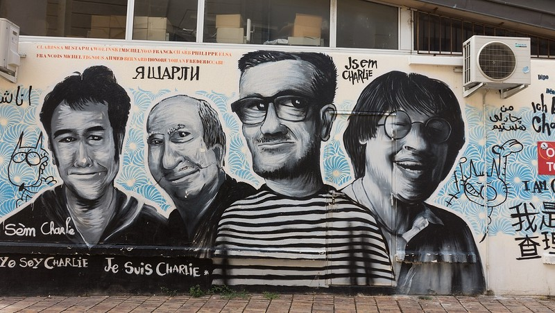 Mural of four men on wall