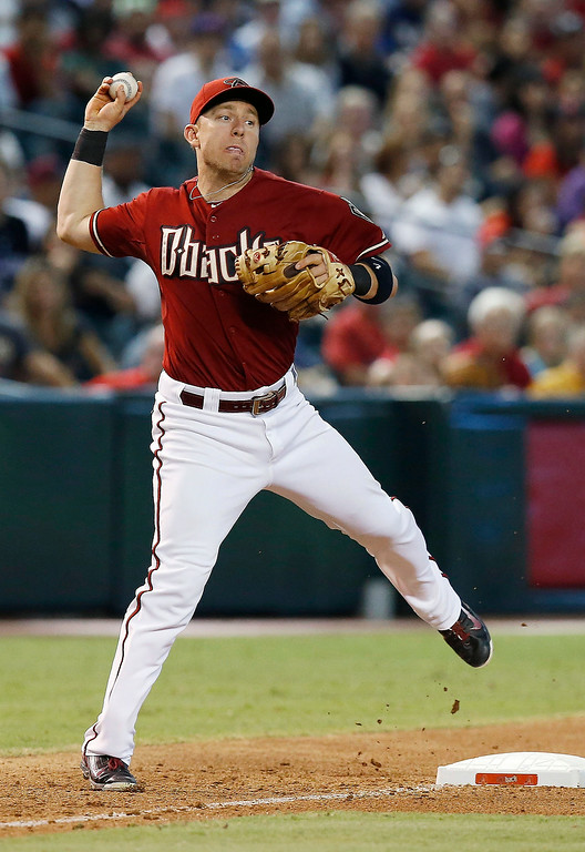 . Arizona Diamondbacks\' Cliff Pennington throws to first base to get Colorado Rockies\' Brandon Barnes out during the seventh inning of a baseball game Sunday, Aug. 31, 2014, in Phoenix. (AP Photo/Ross D. Franklin)