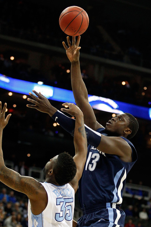 . KANSAS CITY, MO - MARCH 22:  Mouphtaou Yarou #13 of the Villanova Wildcats shoots against Reggie Bullock #35 of the North Carolina Tar Heels in the first half during the second round of the 2013 NCAA Men\'s Basketball Tournament at the Sprint Center on March 22, 2013 in Kansas City, Missouri.  (Photo by Ed Zurga/Getty Images)