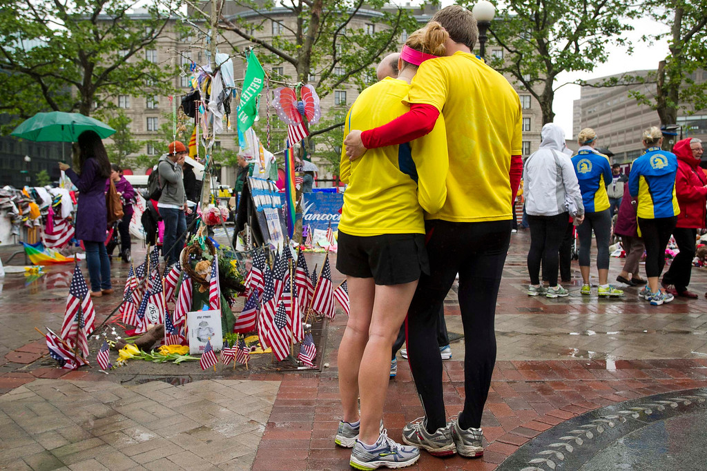 ". Katie Eastman (L) and Kiaren Shaughnessy visit the memorial on Copley Square after crossing the finish line and completing the final mile of the Boston Marathon course during ""#onerun\"" in Boston, Massachusetts, May 25, 2013. Eastman participated in the marathon but was unable to finish when the course was shut down following the bombing attack. The event was organized to give athletes and spectators an opportunity to complete the final mile of the Marathon that was cut short when two bombs exploded at the finish line.   REUTERS/Dominick Reuter"