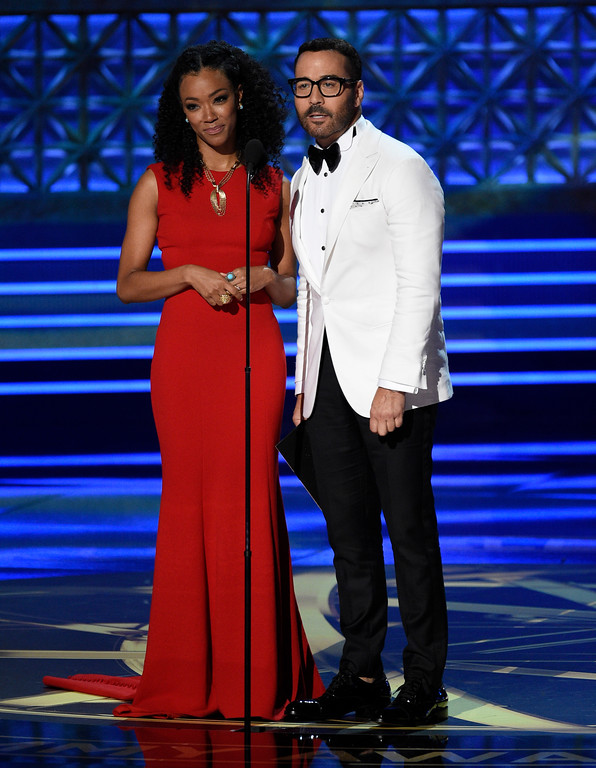 . Sonequa Martin-Green, left, and Jeremy Piven present the award for outstanding supporting actress in a drama series at the 69th Primetime Emmy Awards on Sunday, Sept. 17, 2017, at the Microsoft Theater in Los Angeles. (Photo by Chris Pizzello/Invision/AP)