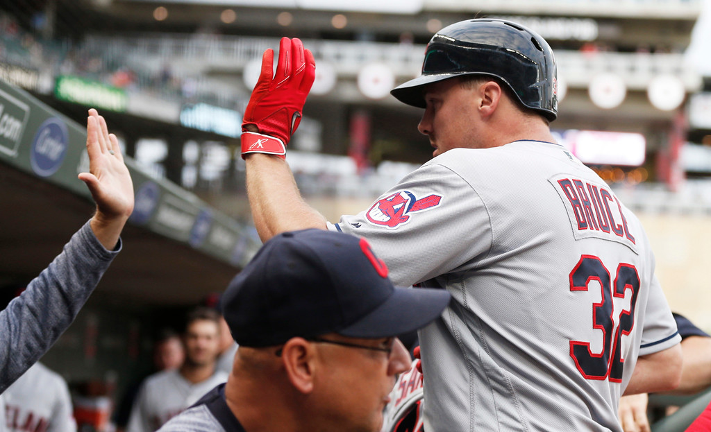 . Cleveland Indians\' Jay Bruce, right, is greeted in the dugout after his solo home run off Minnesota Twins pitcher Aaron Slegers during the fourth inning of the second game of a baseball doubleheader Thursday, Aug. 17, 2017, in Minneapolis. (AP Photo/Jim Mone)