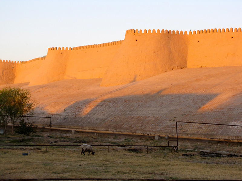 by the old walls in Kiva at sunset