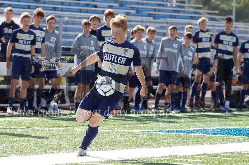 Butler forward Emerson Douthett controls the ball to push downfield in Saturday's opening-round playoff win against Connellsville. Seb Foltz/Butler Eagle