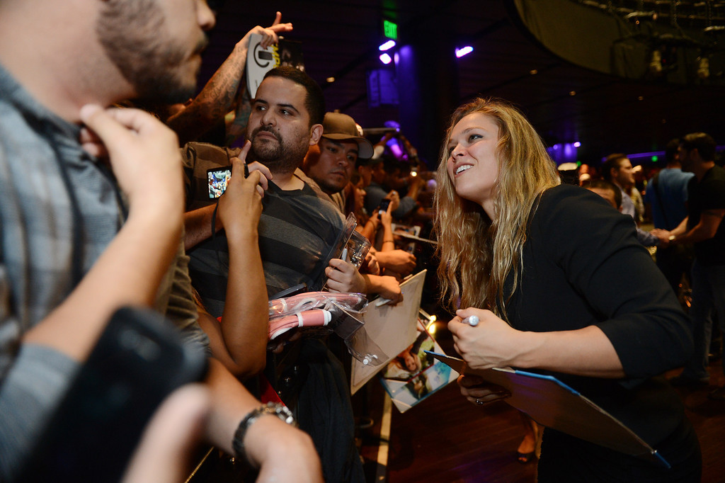 . UFC woman\'s bantamweight champion Ronda Rousey signs autographs during the UFC World Tour at Club Nokia Tuesday, July 30, 2013 in Los Angeles. (Hans Gutknecht/Los Angeles Daily News)