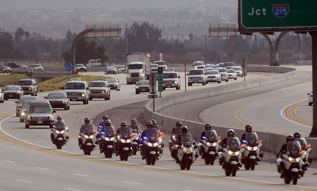 . (Will Lester/Staff Photographer) The funeral procession for San Bernardino County Sheriff Detective Jeremiah Mackay stretched for over 13 miles from San Bernardino to Devore Thursday morning February 21, 2013. MacKay was shot and killed February 12 by Christopher Dorner in a fierce gun battle in the Angelus Oaks area.