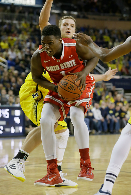 . Ohio State forward Jae\'Sean Tate (1) looks for room during the second half of an NCAA college basketball game against Michigan, Sunday, Feb. 22, 2015 in Ann Arbor, Mich. Michigan defeated Ohio State 64-57. (AP Photo/Carlos Osorio)