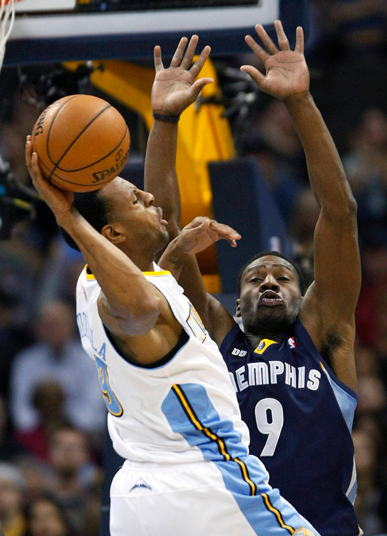 . Memphis Grizzlies forward Tony Allen (9) defends Denver Nuggets center Andre Iguodala (L) going to the hoop in the third quarter of their NBA basketball game in Denver December 14, 2012.   REUTERS/Rick Wilking