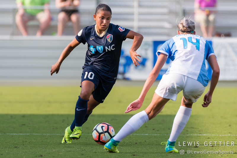 Debinha (10) and Alanna Kennedy (14) during a match between the NC Courage and the Orlando Pride in Cary, NC in Week 3 of the 2017 NWSL season. Photo by Lewis Gettier.