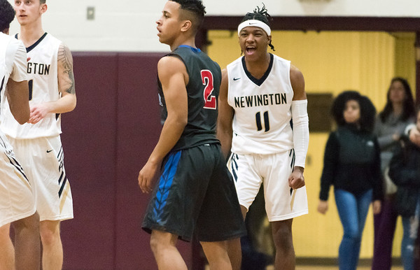 12/27/18 Wesley Bunnell | Staff Newington basketball vs St. Paul on Thursday evening played at Farmington High School. AJ Fair (11) reacts after a refs call in Newington's favor.