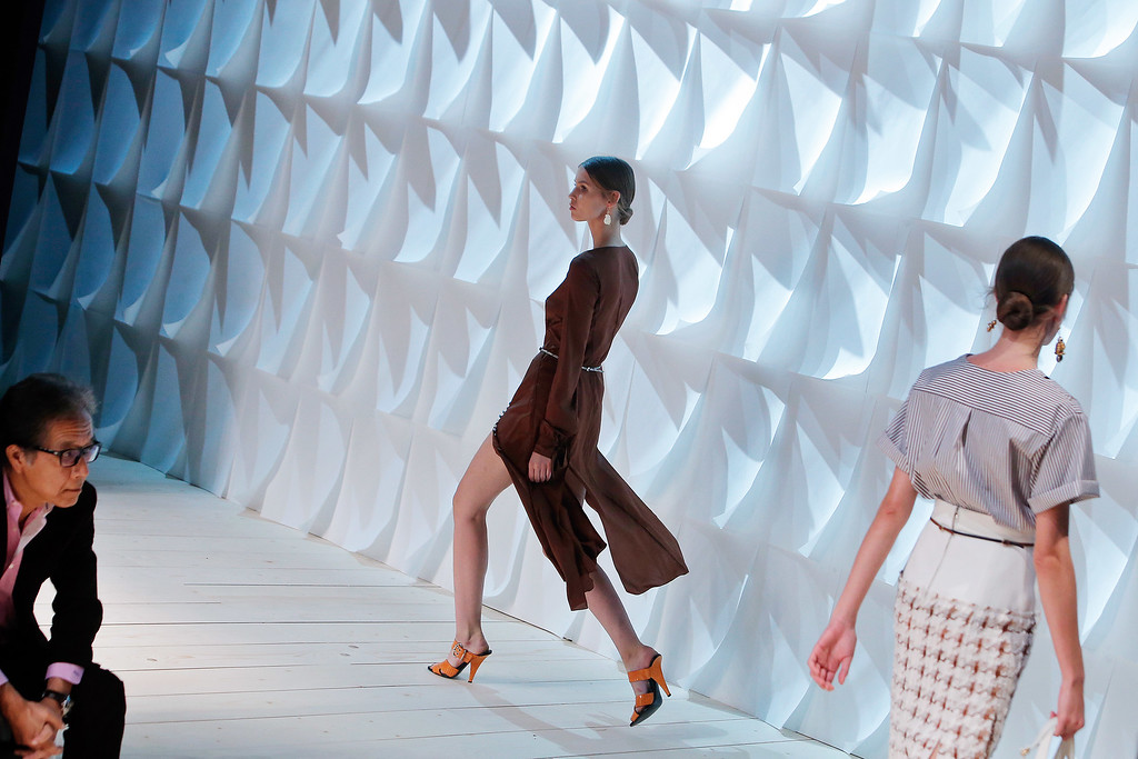 . Models wear creations for Nina Ricci\'s Spring/Summer 2015 ready-to-wear fashion collection, presented in Paris, France, Thursday, Sept. 25, 2014. (AP Photo/Thibault Camus)