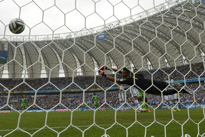 . Argentina\'s goalkeeper Sergio Romero fails to stop a shot by Nigeria\'s forward Ahmed Musa, during a Group F football match between Nigeria and Argentina at the Beira-Rio Stadium in Porto Alegre during the 2014 FIFA World Cup on June 25, 2014.  (JUAN MABROMATA/AFP/Getty Images)