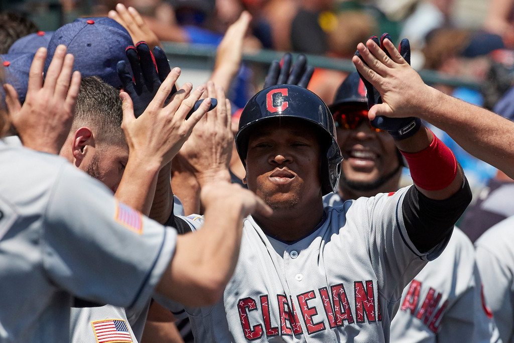 . Cleveland Indians Jose Ramirez is congratulated by teammates after he hits a three run home run against the Detroit Tigers in the fourth inning of a baseball game in Detroit, Sunday, July 2, 2017. (AP Photo/Rick Osentoski)