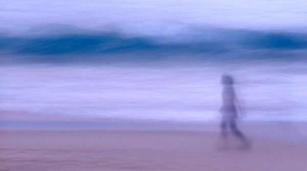 Girl walking on bondi beach long exposure wave