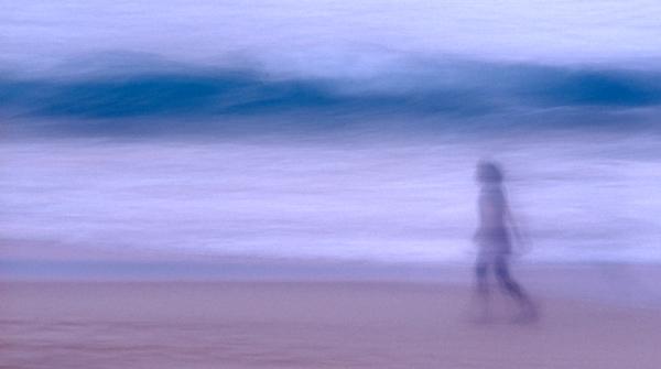 Girl walking on bondi beach long exposure wave