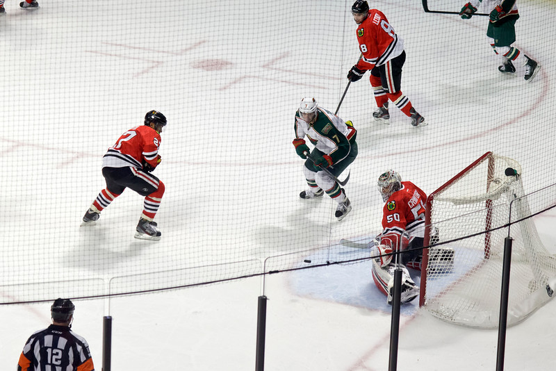 Corey Crawford makes a save during the second period.