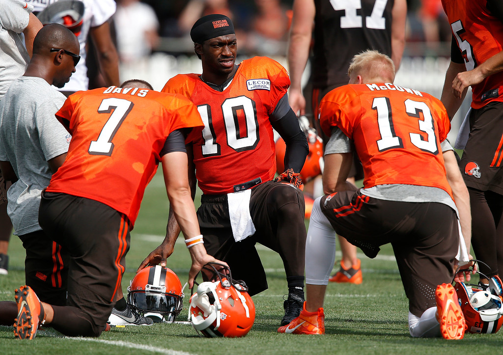 . Cleveland Browns quarterback Robert Griffin III (10) talks with quarterbacks Austin Davis (7) and Josh McCown (13) at the NFL football team\'s training camp Tuesday, Aug. 9, 2016, in Berea, Ohio. (AP Photo/Ron Schwane)