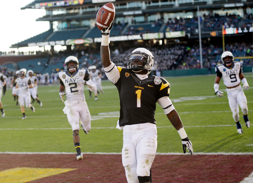 Description of . Arizona State running back Marion Grice (1) celebrates his 39-yard touchdown run against Navy during the second half of the Fight Hunger Bowl NCAA college football game in San Francisco, Saturday, Dec. 29, 2012. (AP Photo/Marcio Jose Sanchez)