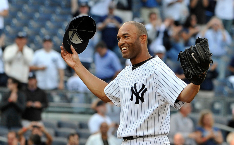 . In this Sept, 19, 2011 file photo, New York Yankees closer Mariano Rivera acknowledges the cheers of the crowd after recording his 602nd career save, after the Yankees beat the Minnesota Twins 6-4 in a baseball game at Yankee Stadium in New York. A person familiar with the decision says that  Rivera plans to retire after the 2013 season. The person spoke to The Associated Press on Thursday, March 7, 2013,  on condition of anonymity because there had been no official announcement. (AP Photo/Kathy Kmonicek, File)