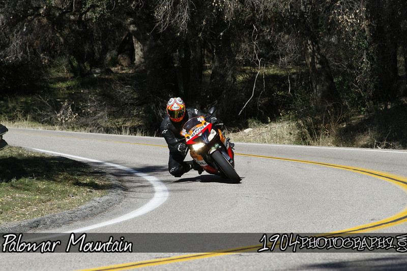 A Honda Repsol replica CBR motorcycle heads down Palomar Mountain on South Grade Road