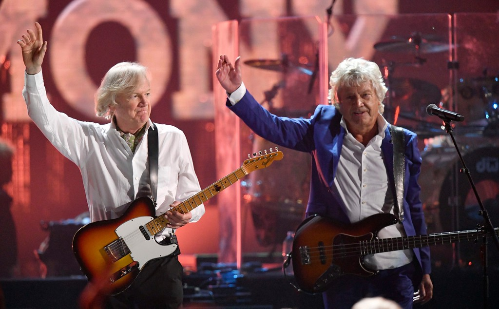 . Justin Hayward, left, and John Lodge of the Moody Blues wave after performing during the Rock and Roll Hall of Fame induction ceremony, early Sunday, April 15, 2018, in Cleveland. (AP Photo/David Richard)