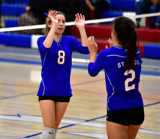 10/4/2019 Mike Orazzi | StaffrSt. Paul's Alexis Carabetta (8) and Greta Panke (2) during Friday night's volleyball match with Crosby in Bristol. r