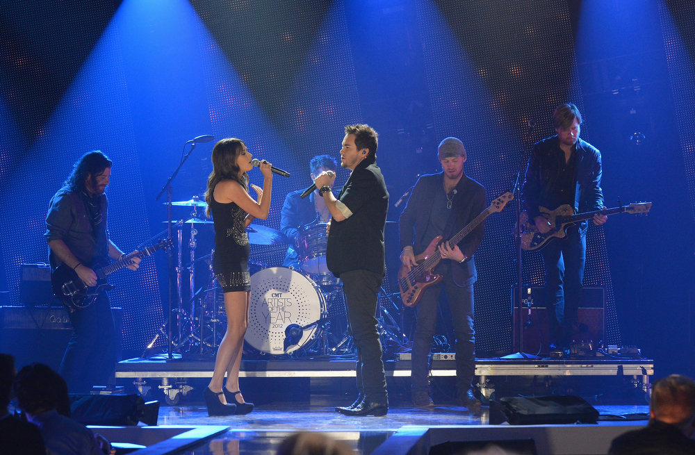 . Kacey Musgraves performs with Mike Eli and the Eli Young Band onstage during the 2012 CMT Artists Of The Year at The Factory at Franklin on December 3, 2012 in Franklin, Tennessee.  (Photo by Rick Diamond/Getty Images for CMT)