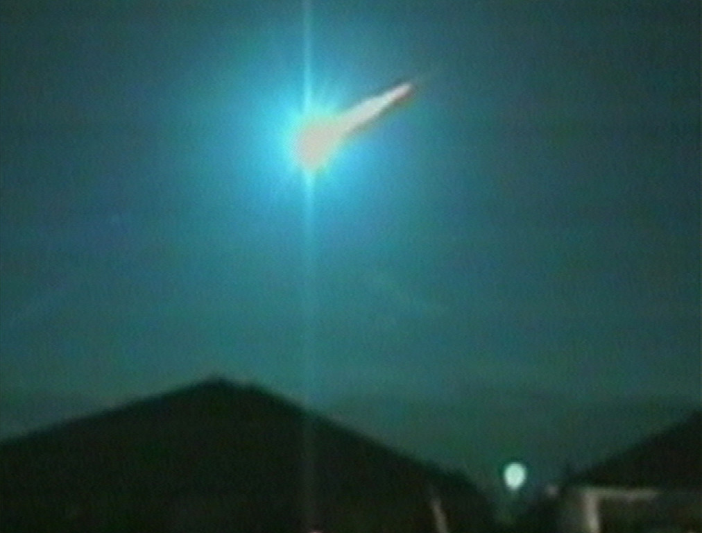 . A meteor streaks across the western Australian sky Saturday, Dec. 3, 2005 in this image taken from television. Residents in Perth, Australia, witnessed a spectacular light show on Saturday night as a meteor blazed through the sky, leaving a bright tail in its wake. The moment was captured on camera by Karun Cowper, who was enjoying a meal with his family at Halls Head, south of Perth. (AP Photo/ AP Television News)