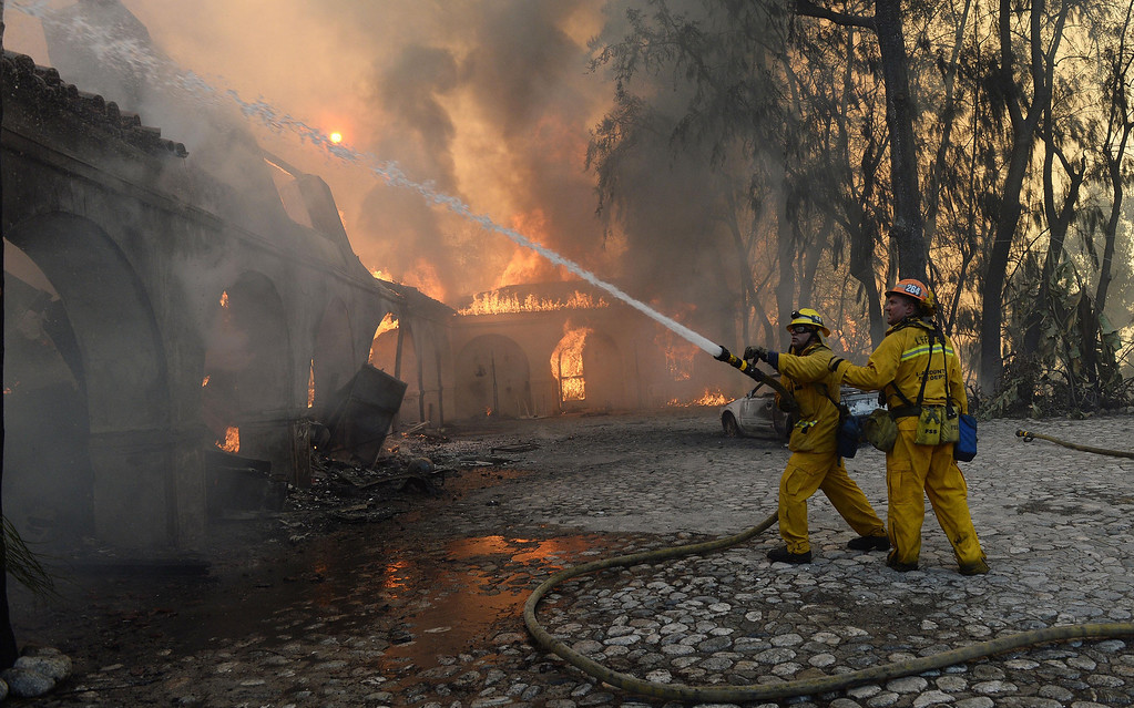 . The Colby Fire burns above Glendora Thursday January 16, 2014. A portion of the former Singer home, of sewing machine fame, partially burned. (Will Lester/Inland Valley Daily Bulletin)