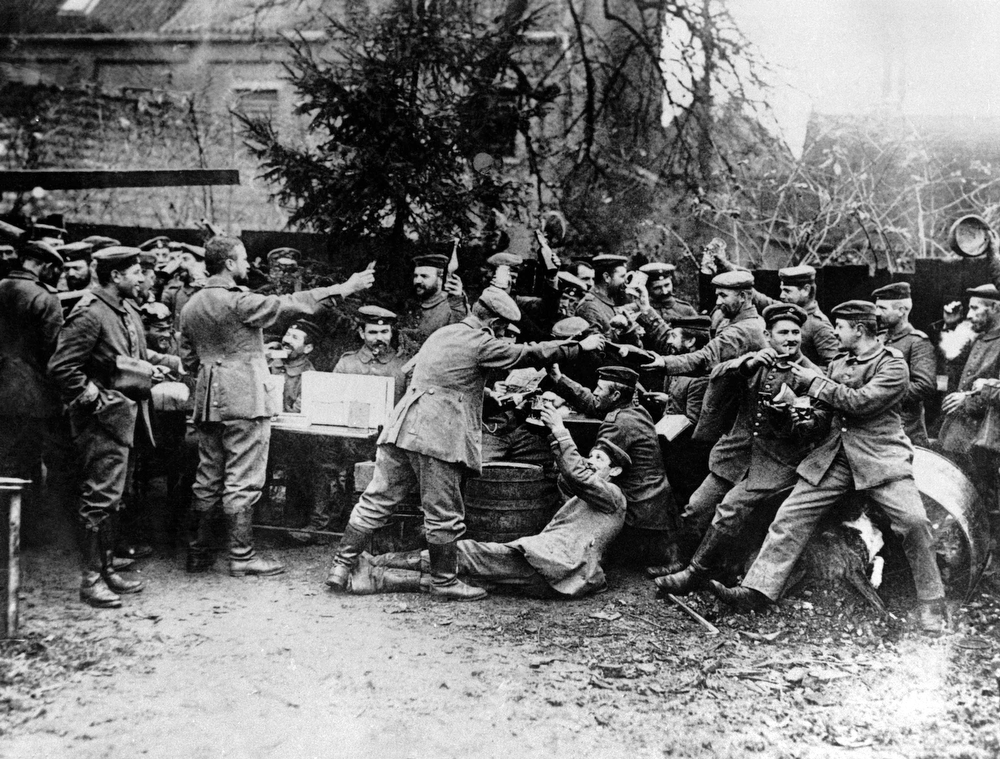 Description of . German soldiers celebrate Christmas during WWI in Germany in an undated photo. (AP Photo)