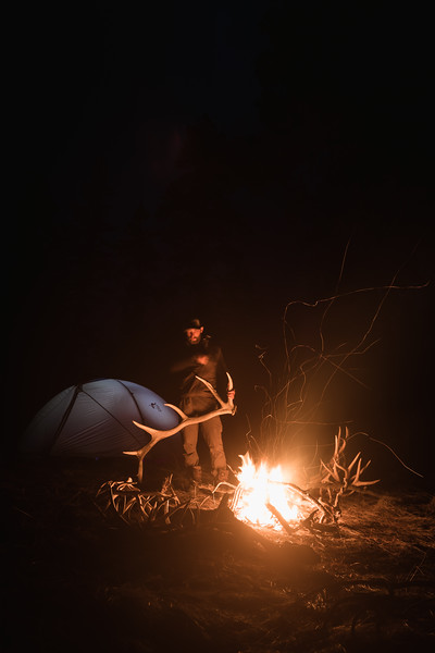 Casey Barton (_caseybarton_) at camp with elk antlers in Oregon.