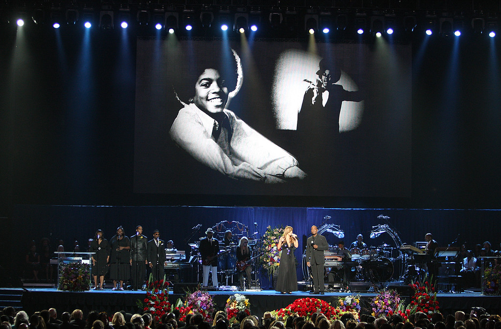 . Mariah Carey, left, and Trey Lorenz, sing under an image of Michael Jackson during the memorial service at the Staples Center, Tuesday, July 7, 2009 in Los Angeles. (AP Photo/Wally Skalij, Pool)